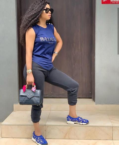 blue sneakers as styled by Toke Makinwa