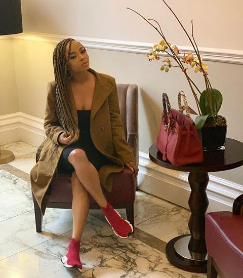 red sneakers as styled by Toke Makinwa