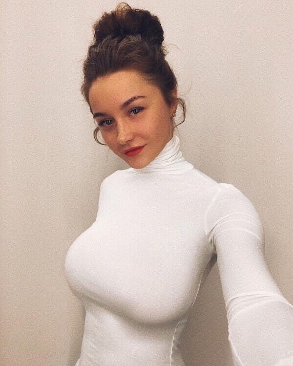 white busty lady with turtle neck - Stylish Outfits for Ladies with Big Boobs
