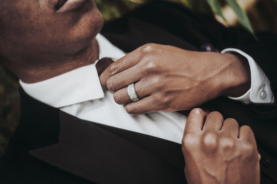 man in suit rocking a marriage ring