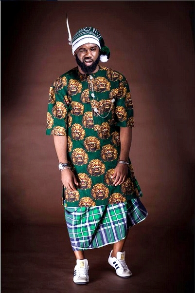 Noble Igwe wears Isi Agu with wrapper and sneakers