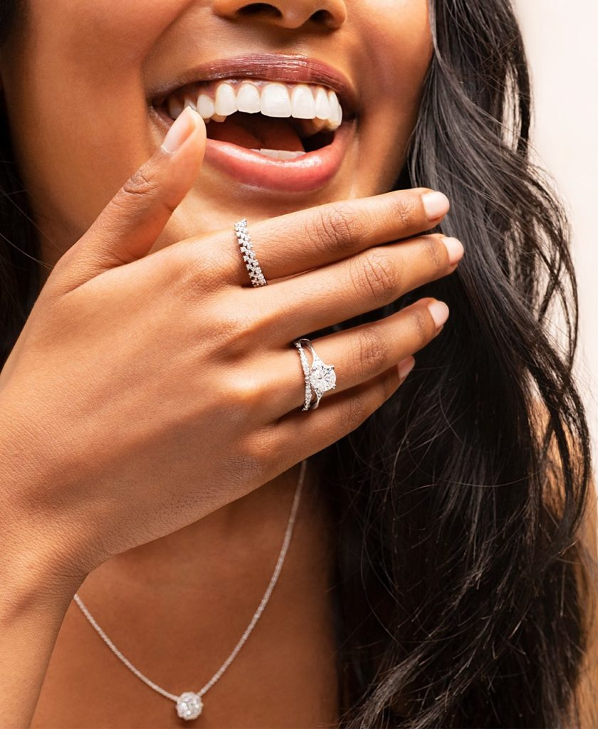 woman wearing rings and laughing